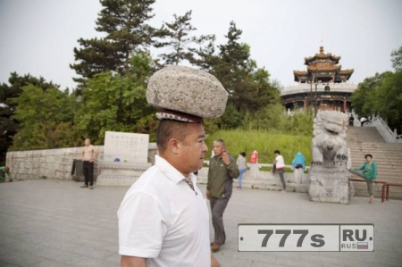 Интересно: китаец похудел при помощи камня