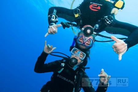 Почему подводное плавание может повредить ваши зубы.