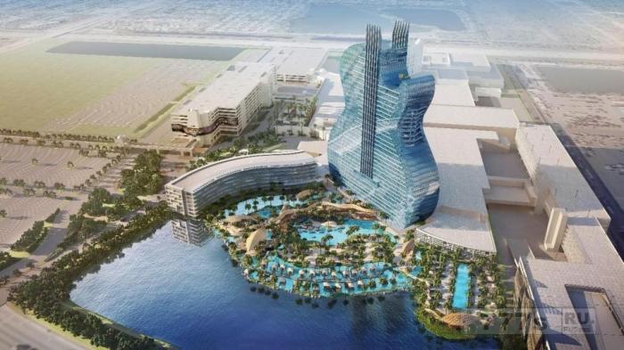 Открывающийся Хард Рок Отель высотой 135 метров представляет собой гигантскую гитару.