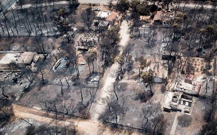 Двадцать человек, обвиняется в смертельном пожаре в Греции