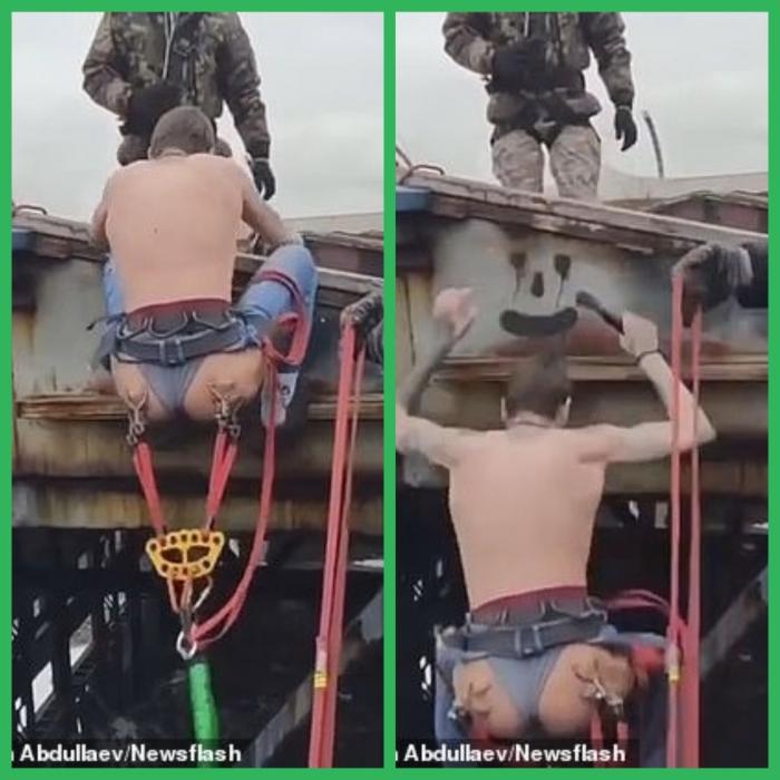Русский смельчак прыгает с заброшенного склада со шнуром, прикрепленным к пирсингу на его ягодицах